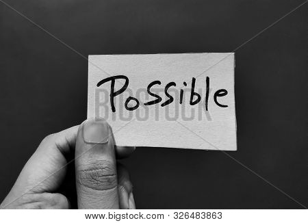 Hand Holding A Paper Card With The Word Possible