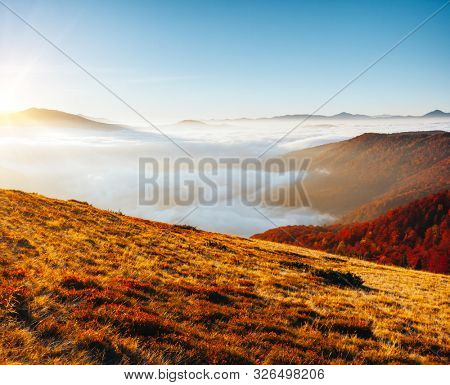 Majestic view of the mountains covered with thick fog. Location place of Carpathian mountains, Ukraine, Europe. Drone photography. Fresh seasonal background. Discover the beauty of earth.