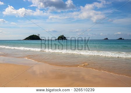 Seaside View With Yellow Beach Sand And Blue Water. White Sand Beach Perspective Landscape. Tropical