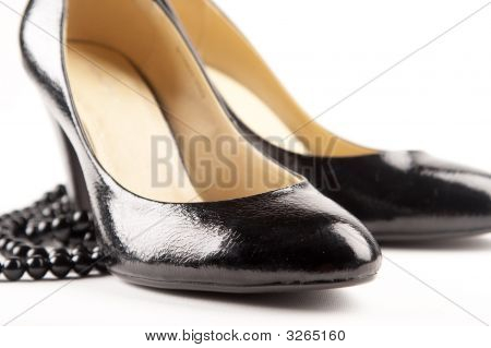 Black Patent-Leather Shoes On The White Background