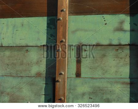 Close View Of Section Of Green Painted Wooden Wagon
