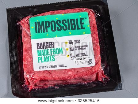 Morgantown, Wv - 8 October 2019: Packaging For Impossible Foods Burger Made From Plants On Steel Bac