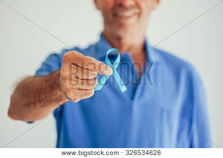Prostate Cancer Awareness. Man With Light Blue Ribbon For Supporting People Living And Illness. Men