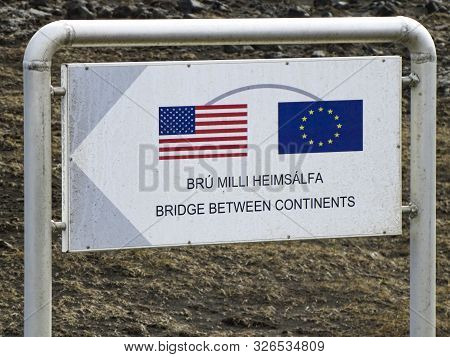 Alfagja, Iceland - May 14, 2015: Sign Of Bridge Between Continents In Álfagjá Rift That Connects Two