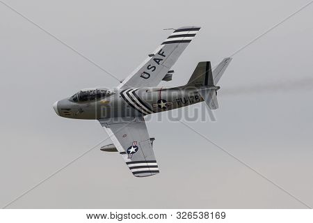 NORTH AMERICAN F-86A SABRE, ENGLAND, 8 SEPTEMBER 2007, Air to Air photo of a North American F-86 Sabre or Sabrejet fighter jet airplane flying over the United Kingdom