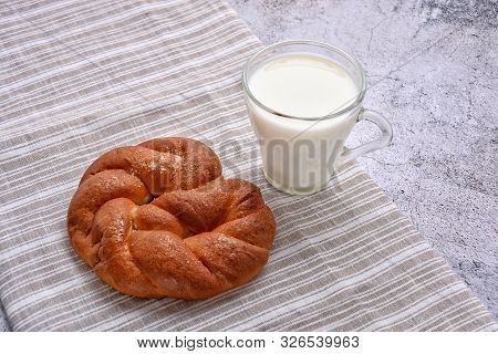 Sweet Pretzel And Glass Of Milk On A Striped Serviette. Delicious Snack. Rustic. Space For A Text.