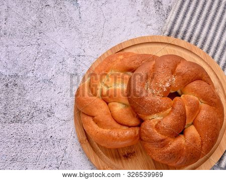 Delicious Pretzels. Sweet Bun On A Wooden Board. Striped Serviette. Top View. Space For A Text.
