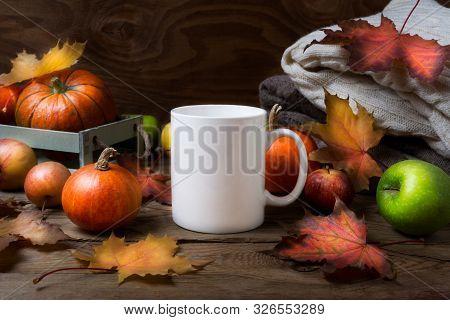 White Coffee Mug Mockup With Fall Maple Leaves, Apples And Pumpkins. Empty Mug Mock Up For Design Pr