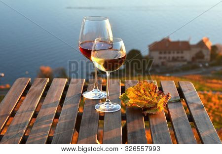 Wine glasses against Geneva lake. Lavaux, Switzerland