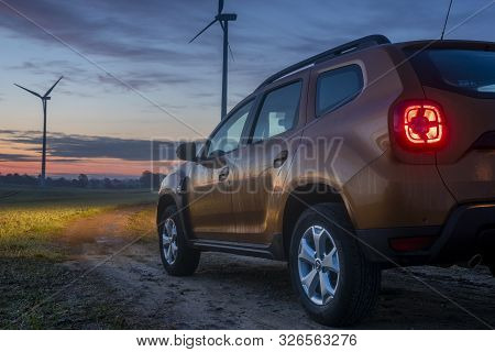 Brandenburg, Germany-october 2019: New Suv Model Dacia Duster When Driving Off-road Before Sunrise