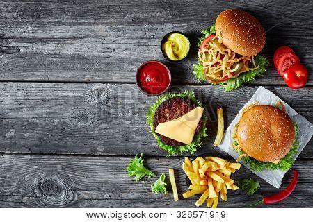 Three Cheeseburgers With Beef Patties, Cheddar Cheese, Crispy Fried Onions, Lettuce, Sliced Tomatoes