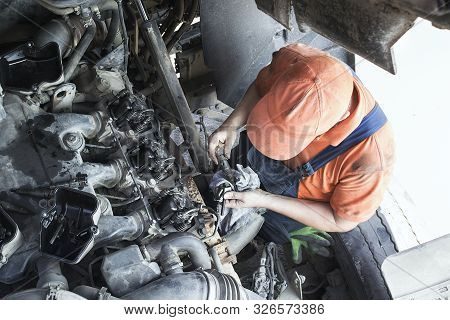 Mechanic Repairs A Truck. Adjustment Of Valves Of The Diesel Motor. Replacement Nozzles.