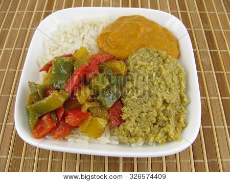 Cooked Rice With Olive Paste And Cooked Colorful Paprika