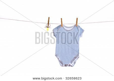 Colorful baby goods hanging on the clothesline