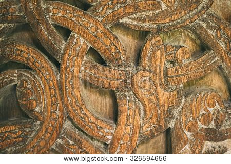 Borgund, Norway. Carved Details Of Famous Wooden Norwegian Landmark Stavkirke. Ancient Old Wooden Tr
