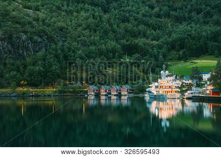 Flam, Norway. Famous Red Wooden Docks In Summer Evening. Small Tourist Town Of Flam On Western Side