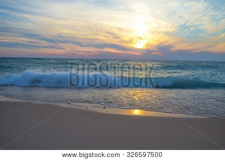 Waves On The Beach. Sunset Beach Background As Waves Crash Onto The Sandy Coast Of Lake Michigan. Sl