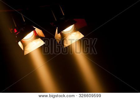 Two Theatre Spotlights On A Black Background