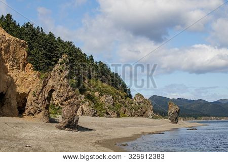 A Beautiful Stone Outliers Or Rock Formations On The Coast Of The Sea Of Okhotsk. Cape Velikan, Isla