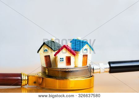 House On Magnifying Glass For Search And Explore Real Estate, Houses, Apartments For Investment. Ris