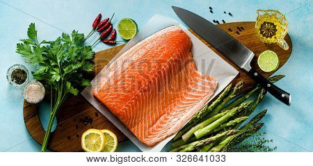 Banner Of Fresh Salmon Slice On A Wooden Cutting Board With Fresh Aromatic Herbs And Asparagus On Th