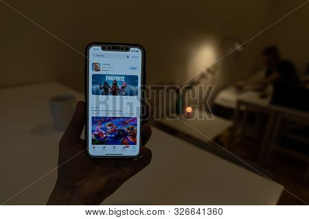 Elva, Estonia November 15, 2018 Girl Holding Iphone With Online Fortnite Game Epic Games In App Stor