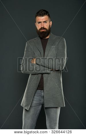 Confident And Attractive. Confident Hipster On Grey Background. Bearded Man Keeping Arms Crossed. Co