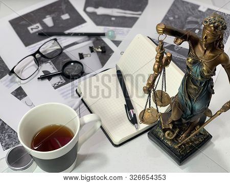 Desk Detective. Evidence Of Crime, On The Desktop Of A Policeman. Workplace Of A Lawyer. Download Ma