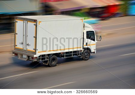 Motion Image Of The White Truck Driving With Speed