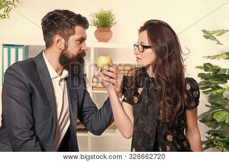 Best Vitamin Snack. Bearded Man And Sexy Woman Taking Snack Break In Office. Sensual Secretary And B