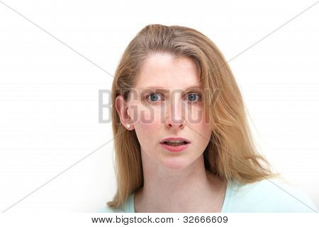 Blonde Girl Wide Eyed At Recent News