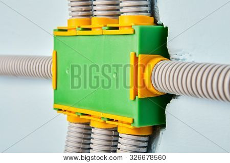 A Flexible Plastic Electrical Conduit Is Connected To The Power Distribution Box Of The Home Wiring