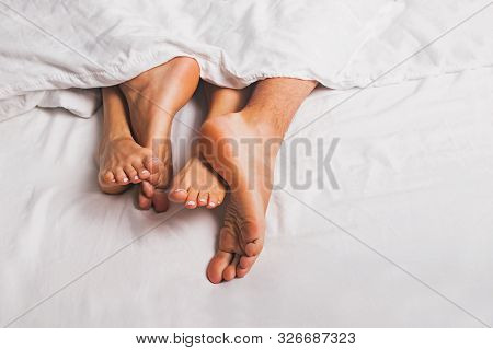 Feet Of Man And Woman Having Sex In A Bed