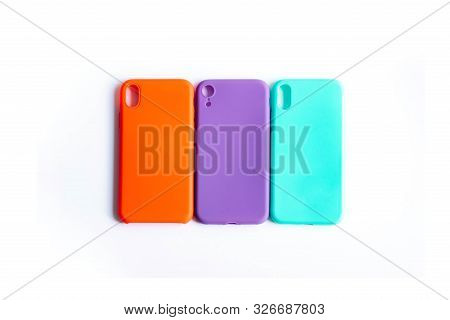 Mint, Orange And Purple Cases For The Smartphone On The White Background. Protective Silicone Cases