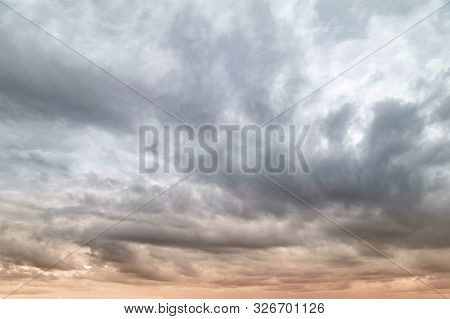 Dark Clouds. Sky With Lots Of Leaden Gray Clouds In The Evening At Sunset. Natural Background For Cr