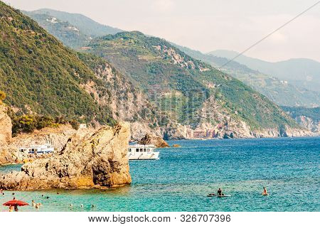 Monterosso Al Mare, Italy - September 02, 2019: People Swimming In The Sea, Yachts And Boats Traveli