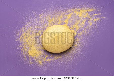 Yellow Dough Made Of Corn Flour For Cornbread On A Purple Background. Above View Of Cornbread Dough