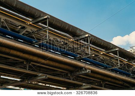 Industrial Tiered Steel Flyover With Pipelines. Outdoors.