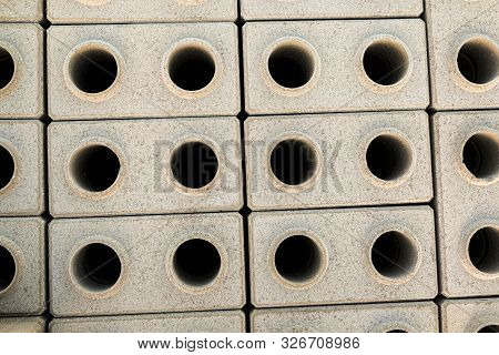 Hyper-pressed Hollow Facing Bricks Stacked On A Pallet. Top View.