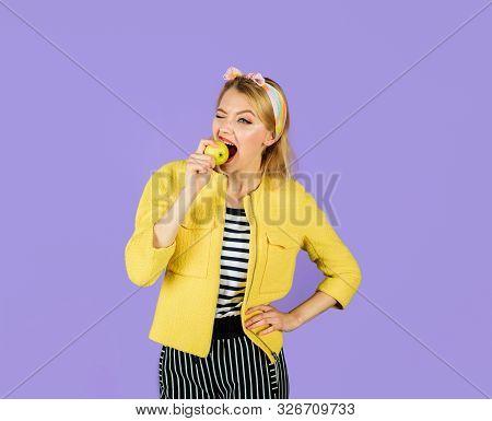 Eating Healthy Food. Girl Bites Apple. Pretty Girl Bites Fresh Apple. Organic Natural Product. Fruit