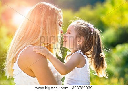 Kids Love. Lifestyle Portrait Mom And Daughter In Happy Mood At The Outside. Happy Loving Family - M