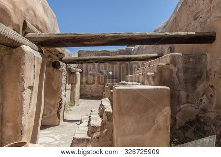 Historic Native Pueblo Interior. Empty interior of ancient adobe in the American Southwest desert at Tumacacori National Park in Arizona poster