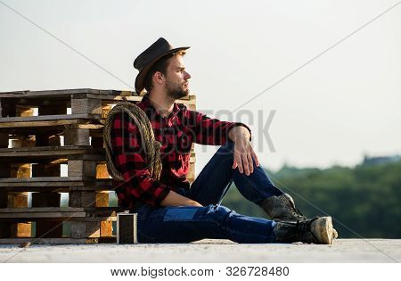 Farmer Enjoy View From His Farm. Romanticism Of Western Culture. Farmer In Hat Sit Relax. Peaceful M