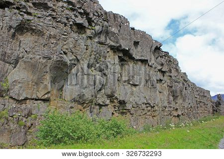 lava wall in iceland on a cloudy day