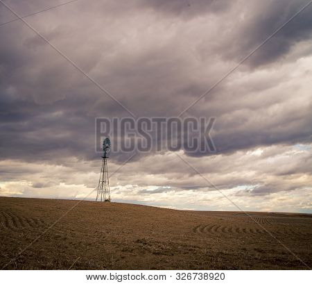 Steel Windmill With Cloudy Skies In The Palouse Area Of Washington State