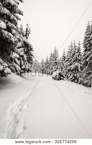 Winter Mountain Scenery With Wooden Shelter, Trees And Trail Covered By Snow Bellow Lysa Hora Hill I