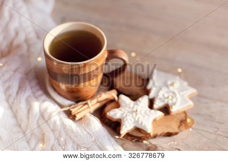 Christmas Tea Time. Mug Of Hot Steamy Beverage, Gingerbread Cookies At Wooden And Knitted Background