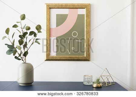 Modern And Luxury Interior Of Living Room With Pomegranate Shelf, Gold Table Lamp, Mock Up Poster Fr