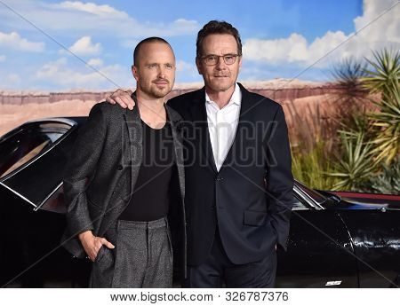 LOS ANGELES - OCT 07:  Aaron Paul and Bryan Cranston arrives to the Netflix premiere of