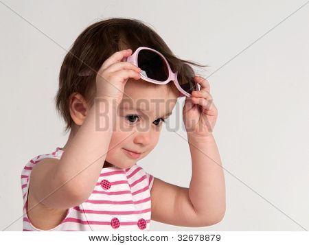 Little girl trying on sunglasses